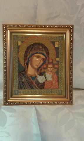 Две иконы Казанской Божьей матери в различной технике