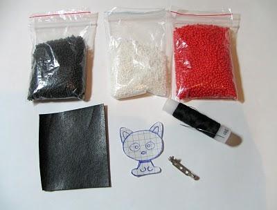 Для изготовления броши из бисера подготовим следующие материалы: - бисер черного и белого цвета (12)...