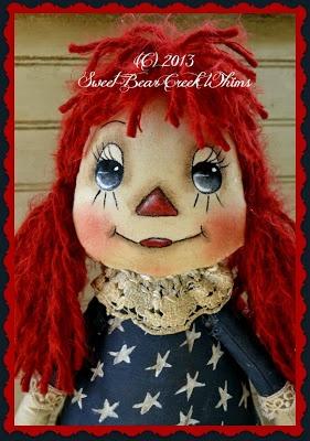 Роспись лица примитивной куклы.